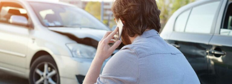 Driver calling for help following a car accident
