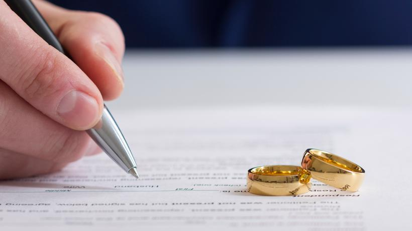 Two rings on a legal form that is being signed.