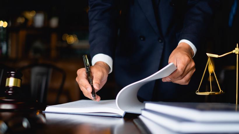 A lawyer filling out legal documents.