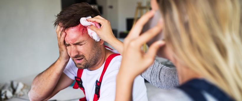 This image shows a woman assisting a man after he suffered a brain injury.