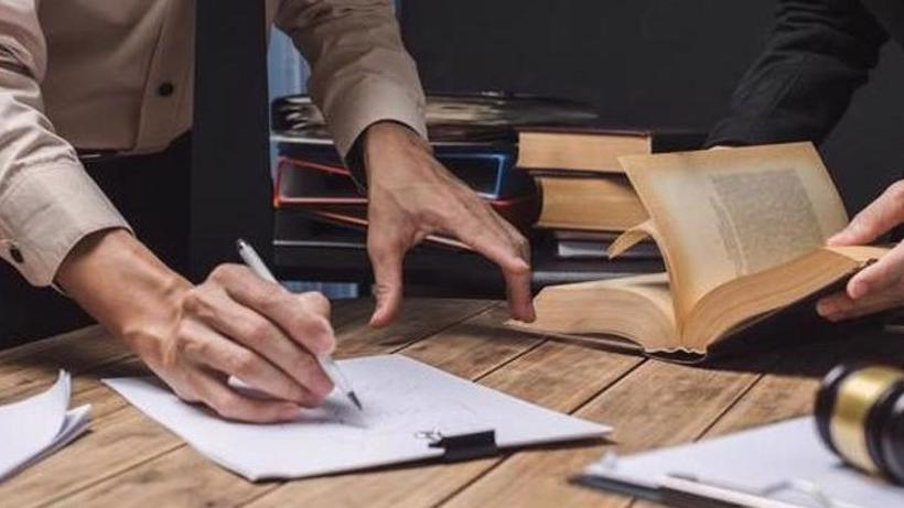 A Peachtree City car accident lawyer filling out legal forms.