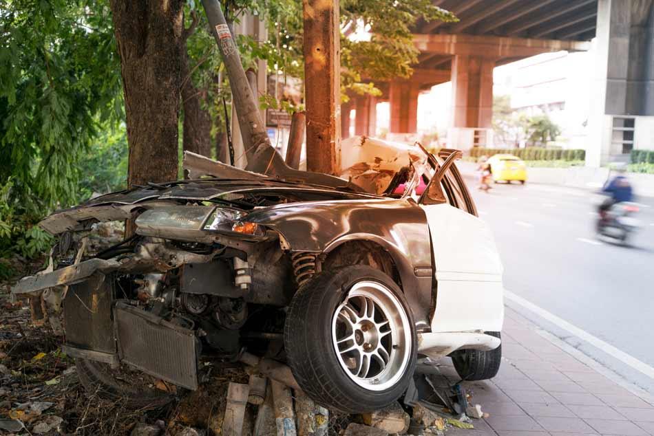 A car ran into a guard rail.
