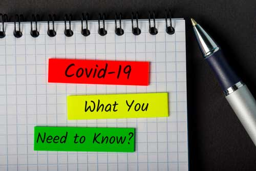 a notepad that says covid-19.