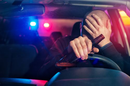 Man being pulled over by police for drunk driving, concept of Fayetteville drunk driving accident lawyer