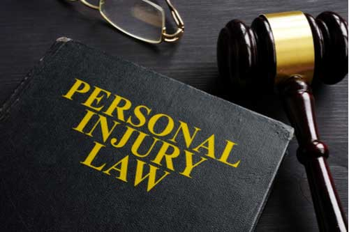 Personal injury law book, concept of liability, Peachtree City personal injury lawyer
